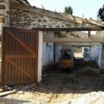 Dépose des pavés et de la couverture garage et mise en place de la nouvelle charpente
